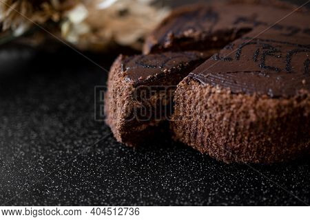 Piece Of Cake. Sliced Tasty Chocolate Cake. Chocolate Cake With A Cut Piece On Blurred Background, C