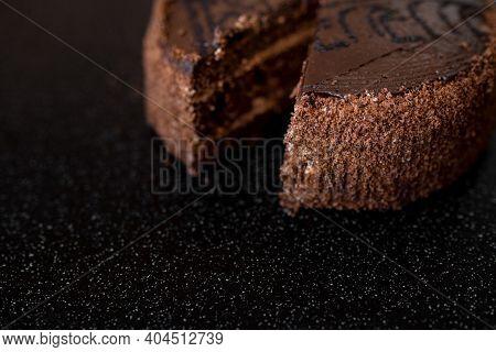 Piece Of Cake. Sliced Tasty Chocolate Cake. Chocolate Cake With A Cut Piece On Black Background, Clo