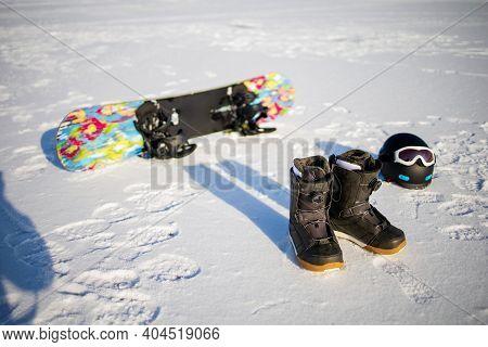 Set Of Snowboard Equipment Outdoor On Snow