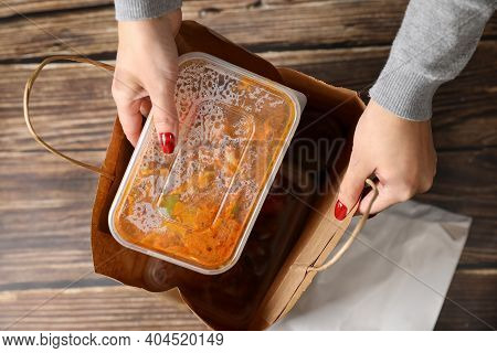 The Female Hands Close Up Pulls Food In Plastic Bags From The Bag. Order The Food At Home. Food Deli
