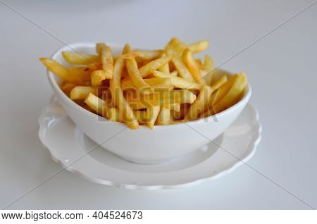 Fries , French Fries Or Fried Potato Dish In White Background