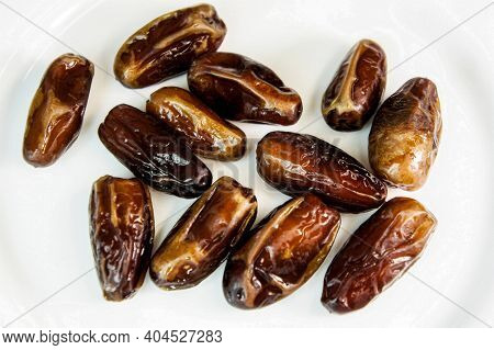 Dates. Dried Dates On A White Background. Sweet Fragrant Delicious Brown Shiny Dates. Dried Fruits