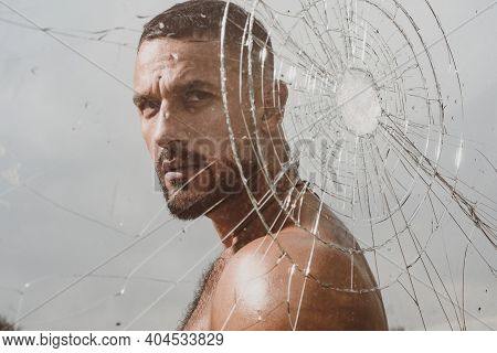 Glass Crack. Emotions Control. Man Behind Crushed Glass. Crush Test