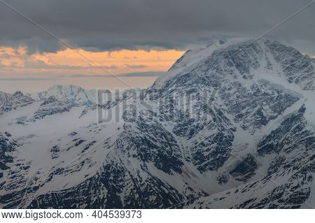 Mountains Covered With Snow At Sunset At Dusk. Part Of The Mountains Of The Elbrus National Park. No