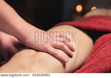 Close-up Of Professional Knee And Hip Massage. Male Masseur Doing Massage To Male Client
