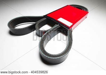 Wide Poly-v Bypass Belt For Internal Combustion Engine Attachments In Red Carton. New Spare Alternat