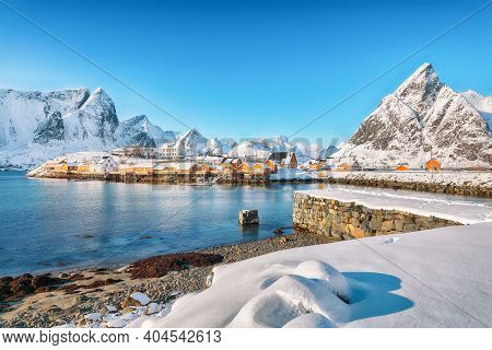 Fabulous Winter View Of Sakrisoy Village And Snowy Mountaines On Background. Popular Tourist Destina