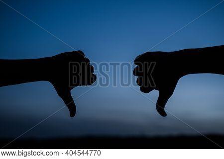Dislike. Thumbs Down. Disagree. Gesture. Man Shows Thumbs Down. Thumbs Down Silhouette.