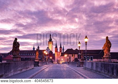 Old Main Bridge, Alte Mainbrucke With Statues Of Saints, Cathedral And City Hall In Old Town Of Wurz