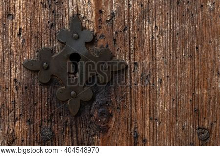 Close-up Of An Antique Metal Knob In An Antique Wooden Door