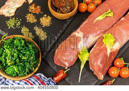 Pork Tenderloin. Fresh Raw Meat Prepared For Cooking. Organic Pork Meat On Chopping Board Ready For