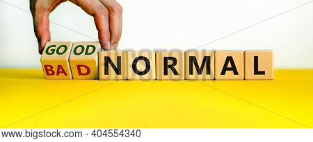 Good Vs Bad Normal Symbol. Businessman Turns Wooden Cubes And Changes Words 'bad Normal' To 'good No