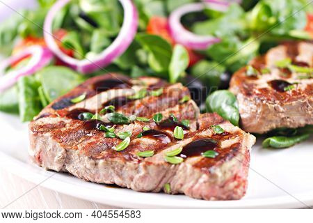 Fillet Of Beef With Mixed Salad On A Plate.