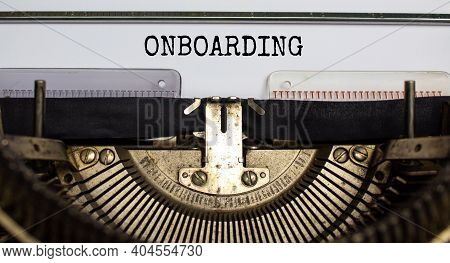 Onboarding Symbol. The Word Onboarding Typed On Retro Typewriter. Business And Onboarding Step One C