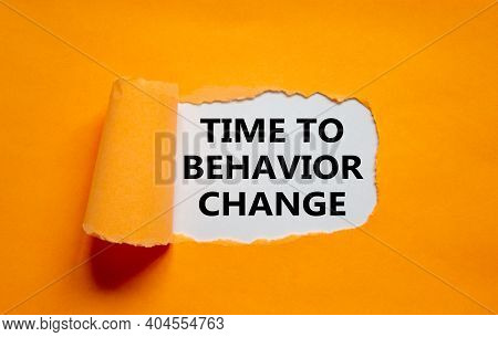 Time To Behavior Change Symbol. The Text 'time To Behavior Change' Appearing Behind Torn Orange Pape