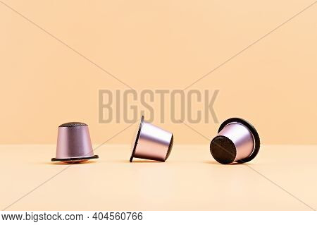 Disposable Coffee Capsules Over Beige Background With Copy Space. Morning Dose Of Caffeine, Energy,