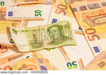 Fifty Euro Money Banknotes Background Texture And Mao Zedong Portrait On 1 Chinese Paper Currency Yu