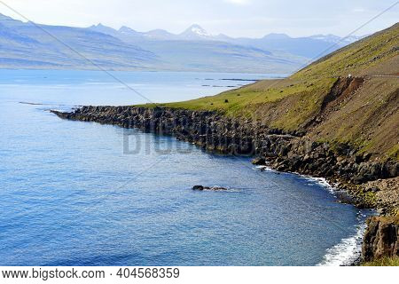 The View Of The Cliffs And Rock Formations By The Ocean Near East Fjords, Iceland During The Summer