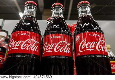 Coca-cola Carbonated Drink In Glass Bottles Are For Sale In Shopping Centers On 20.10.2020 In Russia