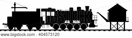Old Steam Locomotive With A Tender At A Technical Stop. Water Tower And Water Crane For Filling Stea
