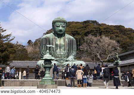 Kamakura, Japan - Feb 15, 2015 : Daibutsu - Famous Great Buddha Bronze Statue In Kamakura, Kotokuin
