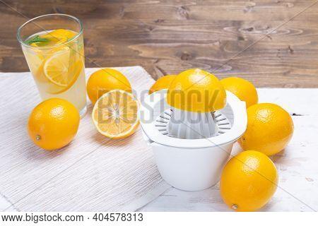 Fresh Cold Lemonade And Ripe Citrus Fruits. Freshly Squeezed Lemon Juice