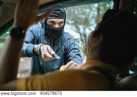 Bandit Man With Masked Robber Holding Knife To Hijack Hostage Man Driver Car Shocked