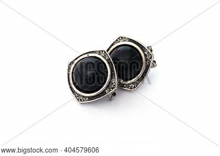 Nineteenth-century Earrings On A White Background. Antique Decoration With Black Stone. Ancient Gree