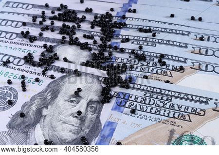 Hundred Dollar Bills. Beads And One Hundred Dollar Bills. Dollars. The Concept Is The Fall Of The Do