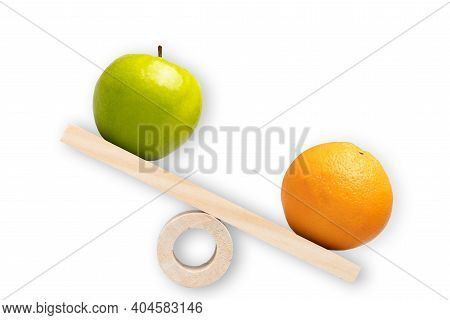 Comparison Of Apple And Oranges. Conceptual Shot Around Comparison, Differentiation, Choice And Sele