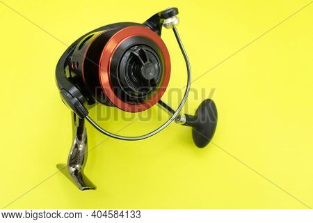 A Variety Of Fishing Reels. Fishing Gear And Accessories. Demo Samples Are Hanging On A Display Case