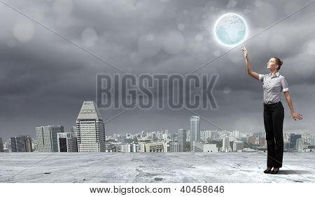 Businesswoman holding the world in the palm of his hand