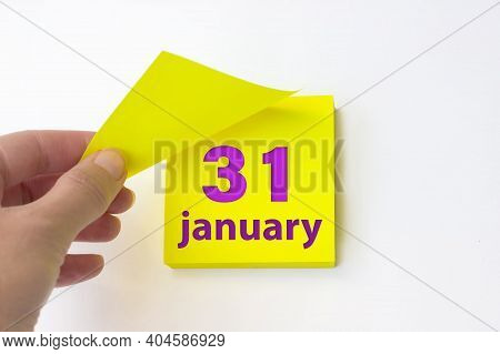 January 31st . Day 31 Of Month, Calendar Date. Hand Rips Off The Yellow Sheet Of The Calendar. Winte