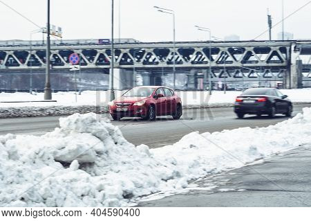 Moscow, Russia - January 15, 2021: Fast Moving Red Opel Astra J Car With Motion Blur Effect. Urban W