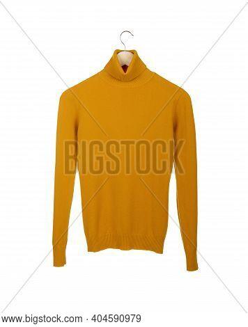 Elegant Yellow Women's Turtleneck Blouse On A Hanger Isolated On White Background.
