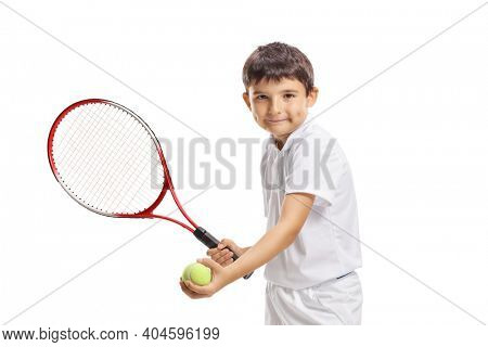 Boy serving a tennis ball with a racquet isolated on white background