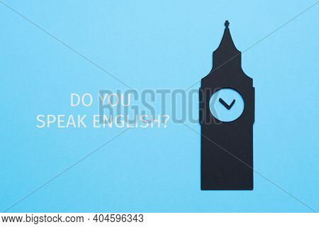 the big ben, cutout on a black paperboard, and the question do you speak english written on a blue background