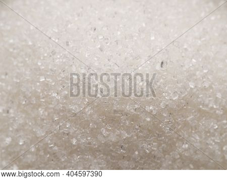 White refined sugar granules close-up. Food background.
