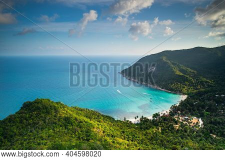 Thailand jungle island aerial: ocean sand beach at resort with lodges, homes, cottages at spring tropical forest. Green asian landscape at sea gulf Koh Tao Isle. Palm trees with bright greenery grass