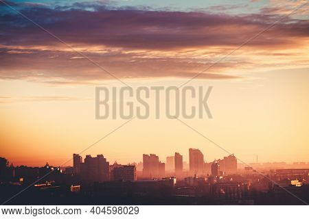 Kyiv aerial cityscape sunrise silhouette illustration: dark cloud on soft light sky. Ukraine, city downtown in morning warm tones. Amazing town skyscrapers, houses, towers, building at cinematic shot