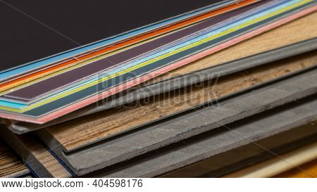 Close up shot of Vinyl plank samples and color samples for home flooring and paint selections