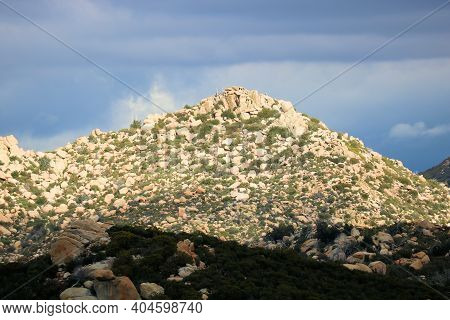 Arid Hills Covered With Large Rocks And Boulders Surrounded By Chaparral Plants Taken On Rural Badla