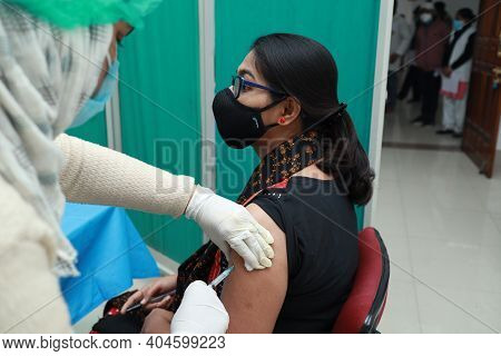January 16 2021, Kishanganj, Bihar, India. A Lady Wearing A Mask Undergoing Covishield Vaccination A