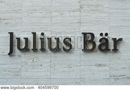 Lugano, Ticino, Switzerland - 14th January 2021 : Julius Baer Bank Sign Hanging On A Building Facade