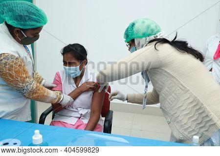 January 16 2021, Kishanganj, Bihar, India. A Nursing Staff Wearing A Mask Undergoing Covishield Vacc