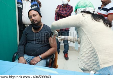 January 16 2021, Kishanganj, Bihar, India. A Health Worker Staff Wearing A Mask Undergoing Covishiel