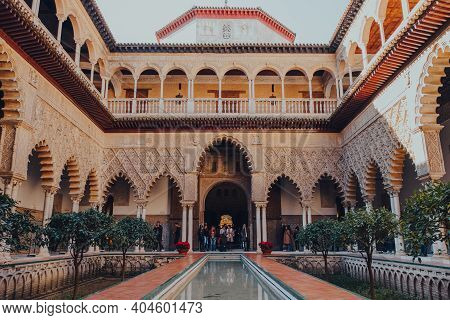 Seville, Spain - January 19, 2020: View Of Patio De Maidens Courtyard Inside Alcazar Of Seville, A R