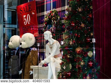 Sales In Stores. An Elegant Colorful Display Window With  Sign Inviting You To Go Shopping. Christma