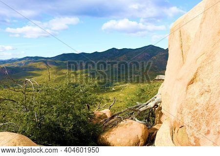 Large Rocks And Boulders On A Mountain Ridge Overlooking Arid Badlands Taken At A Chaparral Woodland