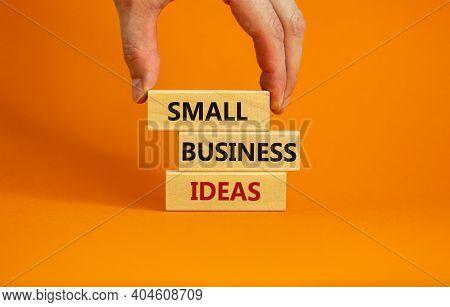 Small Business Ideas Symbol. Wooden Blocks Form The Words 'small Business Ideas' On Beautiful Orange